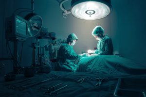 43695106 - surgeons team working with monitoring of patient in surgical operating room.